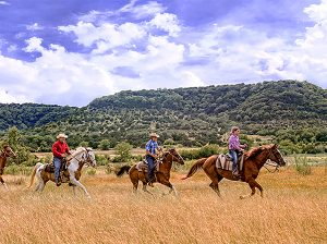 riding horses on teh prairie on the Chisholm Trail in Texas