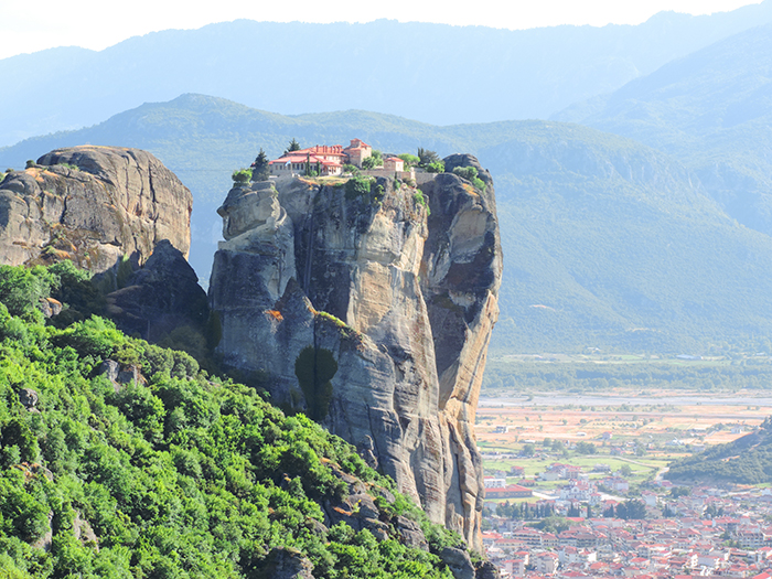 a monastery atop a rocky pinnacle in Meteora