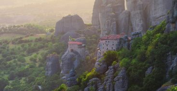 monasteries on a cliff at sunsel