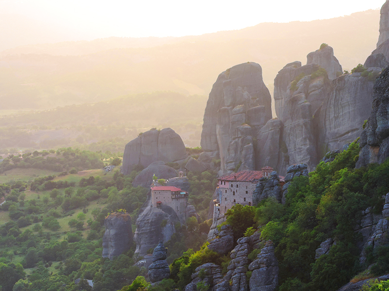 monasteries on a cliff at sunsel in Meteora