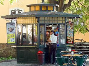 people by a kioskart nouveau