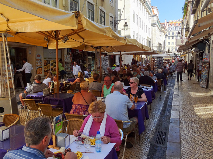 people in outdoor cafes in Lisbon, Portgual