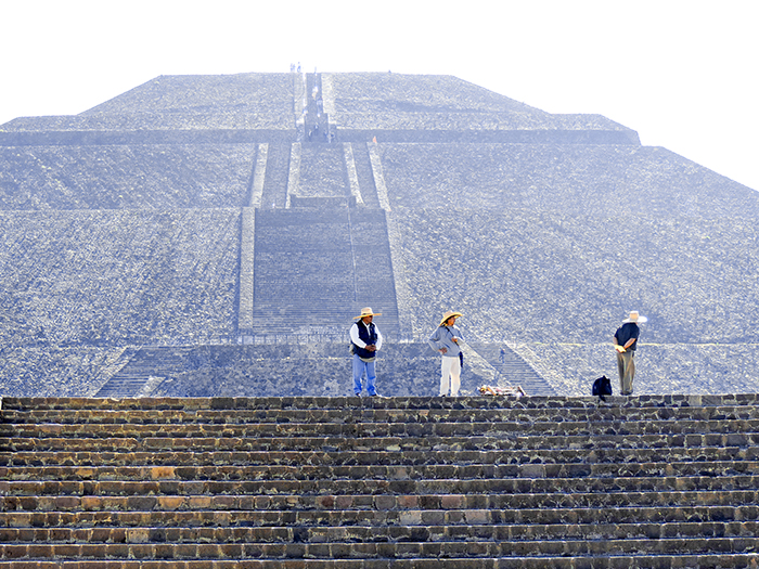 people near an ancient pyramid seen on a day trip from Mexico City