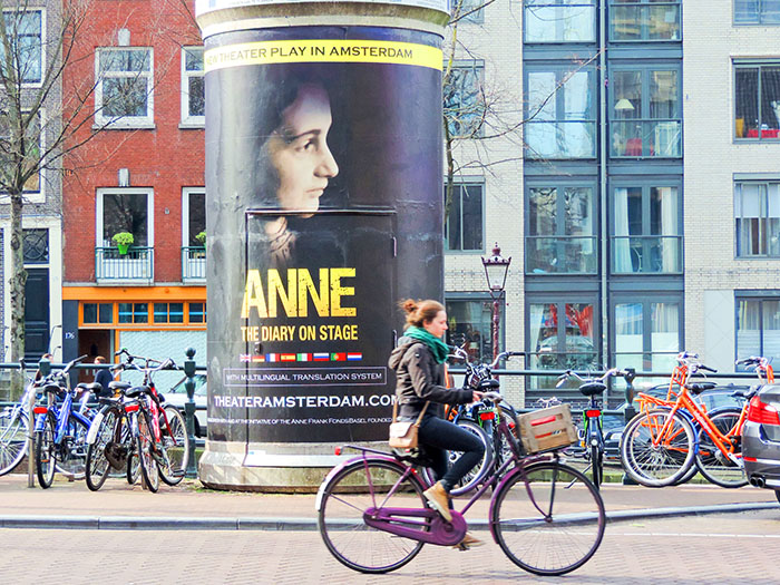 a woman oin a bicycle in Amsterdam
