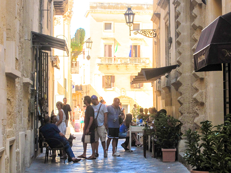 people on a street in Puglia, Italy