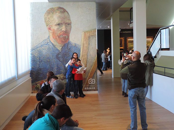 people taking a photo in a museum in Amsterdam