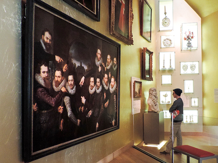 men looking at an exhibit in a museum in Amsterdam