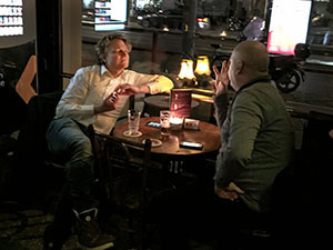 two men at a table in Amsterdam