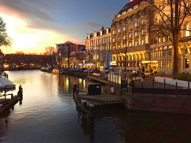 sunset on a canal in Amsterdam