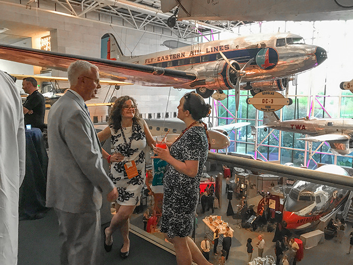 people in an airplane museum in Washington