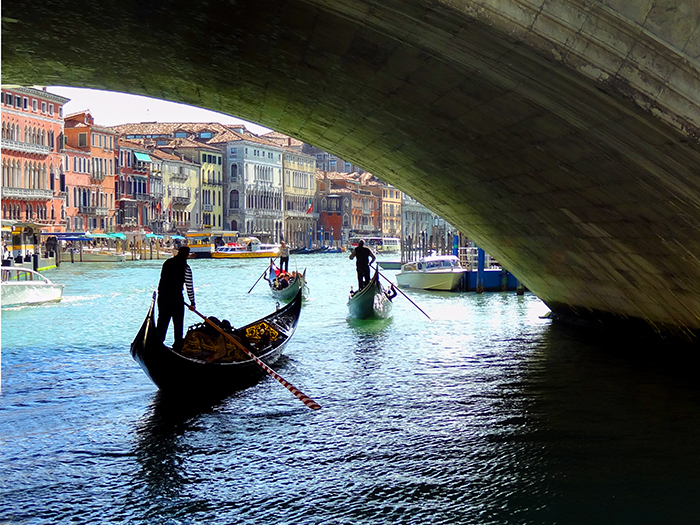 gondolas on a canal in Venice