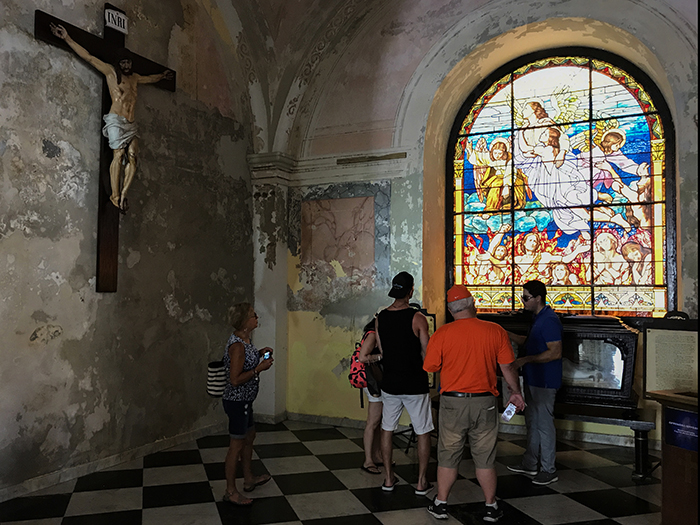 people looking at stained-glass windows in San Juan