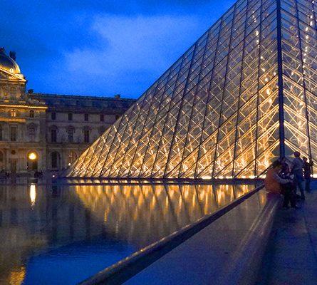 a glass pyramid Budget Travel Tips
