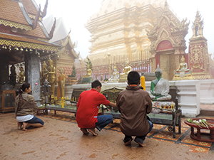 people kneeling at a temple