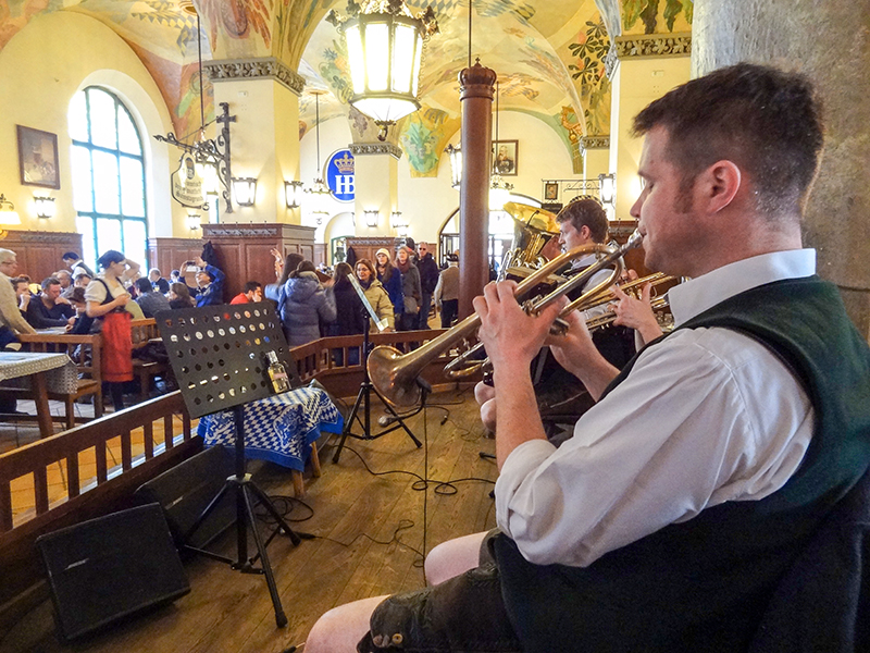 man playing trumpet in a restaurant in Bavaria
