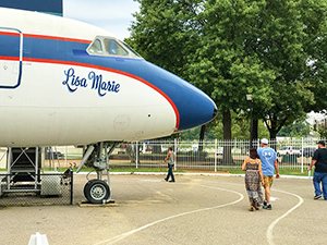 people walking past a plane in Memphis, Tennessee