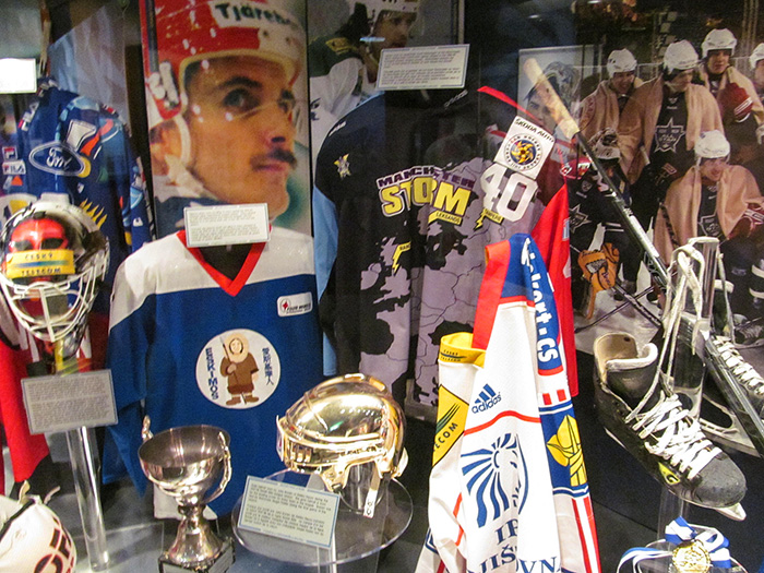 an exhibit of hockey players items