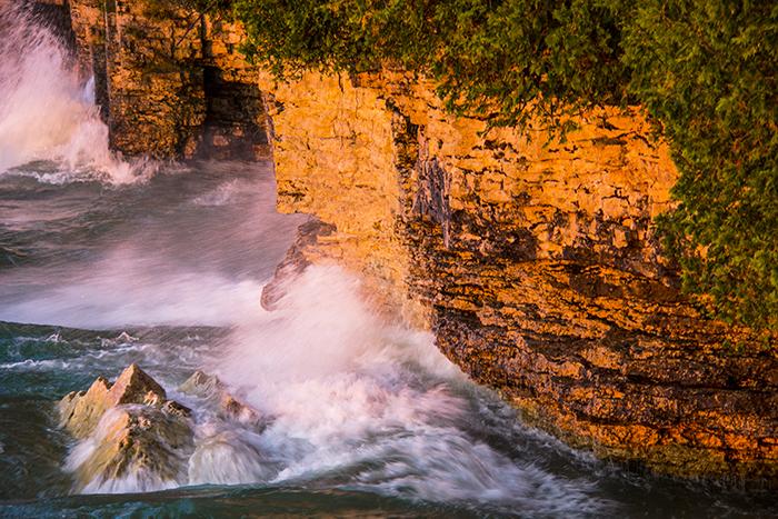 waves crashing on rocks in Door County, Wisconsin