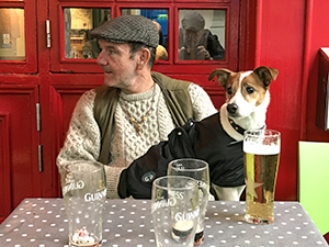 a man and his dog at a table in Galway