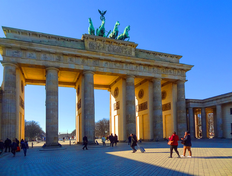 Visitors at Brandenberg Gate, one of the best things to do In Berlin, Germany