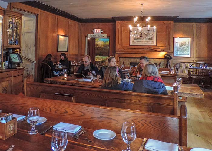 people at tables in Fraunces Tavern, one of the best restaurants in New York City museums