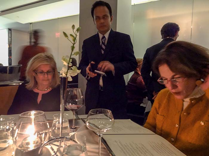 Women looking at menus in the restaurant The Modern, one of the best restaurants in New York City museums