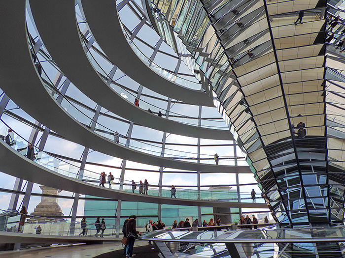 people walking inside the glass dome of the Reichstag, one ofThe Best Things To Do In Berlin, Germany