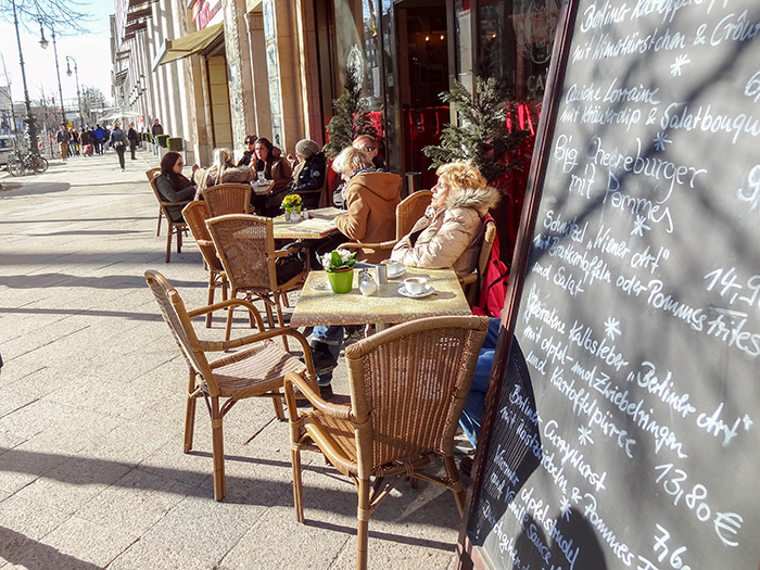 people at an outdoor cafe on the Unter den Linden, one of the best things to do in Berlin, Germany