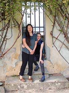 two sudents in a doorway in a study abroad program