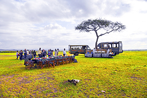 people having breakfast on safari in kenya