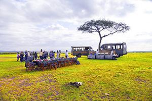 people having breakfast on safari in kenya