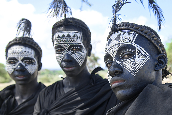 boys with faces painted black in Tanzania