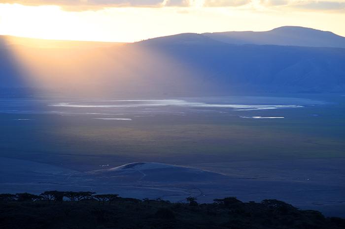 sun setting over a plain in Tanzania