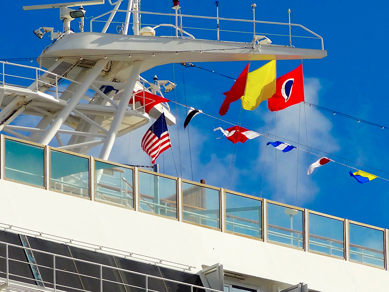 colorful flags on a ship in a survey of the best cruises
