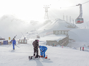 skiers in the snow - travel insurance