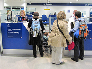 people at an airport with visa