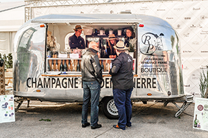a trailer turned into a champagne bar for food festivals in Europe