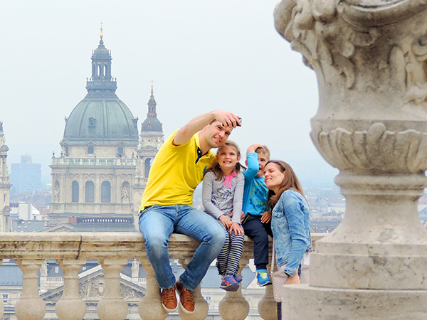 a family taking a selfie - family travel