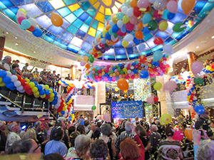 people in a ball room on a Pacific cruise