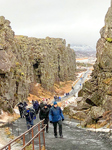 people on a path in a canyon