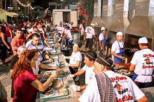 chefs serving sardines