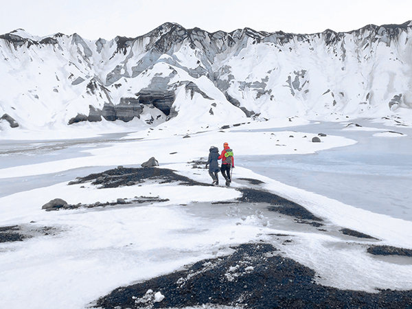 people walking across the snow - Iceland ice caves