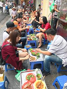 people eating street food - best city in Vietnam