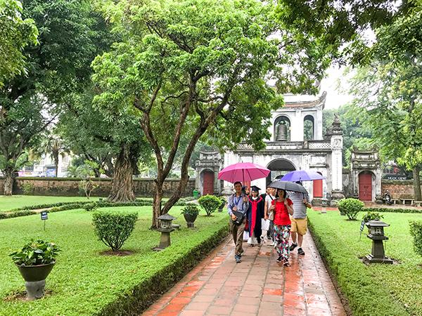 people with umbrellas - best city in Vietnam