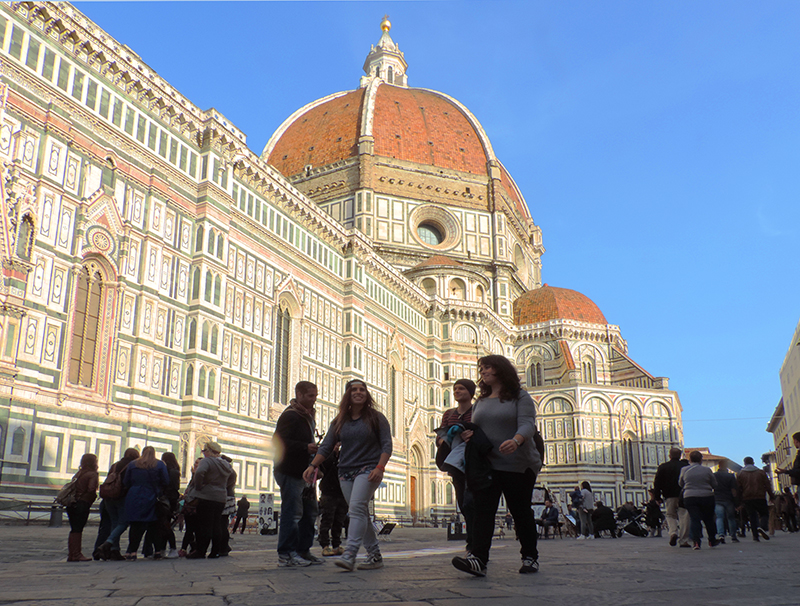 people walking past the Duomo in Florence, one of the best places to visit in Italy