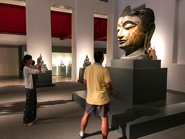 people looking at an exhibit in a museum in Bangkok