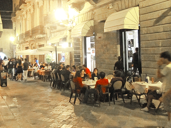 people at outdoor restaurant top 10 in Italy