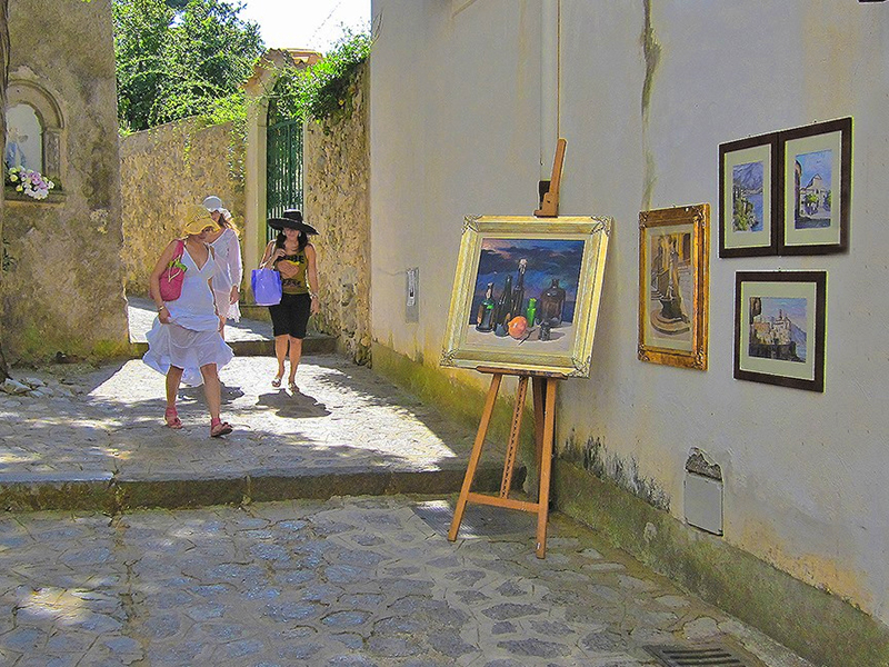 paintings hangin on a wall in Ravello, one of the best places to visit in Italy