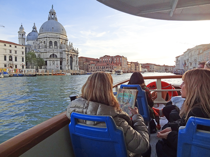 passengers aboard a vaporetto in Venice, , one of the best places to visit in Italy