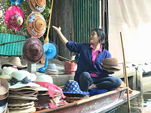 woman selling hats outside Bangkok